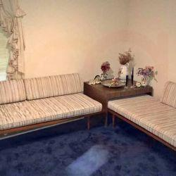 Two Bahama couches with end table